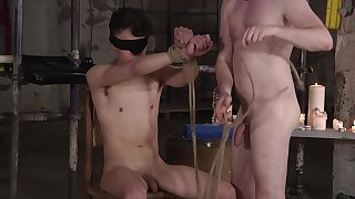 BDSM fetish video respecting a blindfolded gay dude being pleasured