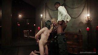 Bi-sexual leash depending endures black cock up the throat